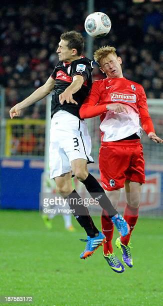 Daniel Schwaab of Stuttgart and Sebastian Kerk of Freiburg jump for a header during the Bundesliga match between SC Freiburg and VfB Stuttgart at...