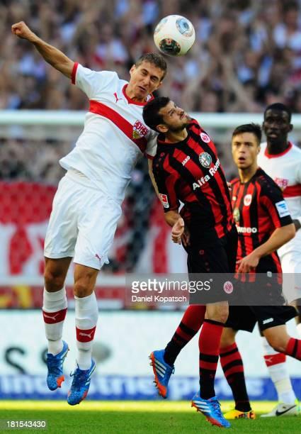 Daniel Schwaab of Stuttgart jumps for a header with Tranquillo Barnetta of Frankfurt during the Bundesliga match between VfB Stuttgart and Eintracht...