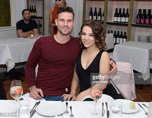 Daniel Scott and Brittany Cherry attend Emma Slater And Sasha Farber's Engagement Dinner at Fig Olive on October 31 2016 in West Hollywood California