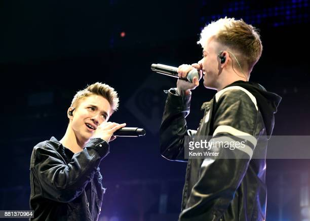 Daniel Seavey and Corbyn Besson of Why Don't We performs onstage at 1061 KISS FM's Jingle Ball 2017 Presented by Capital One at American Airlines...