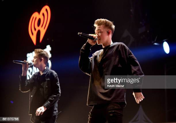 Daniel Seavey and Zach Herron of Why Don't We perform onstage at 1061 KISS FM's Jingle Ball 2017 Presented by Capital One at American Airlines Center...