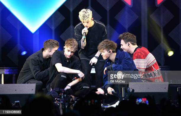 Daniel Seavey Corbyn Besson Jonah Marais Zach Herron and Jack Avery of 'Why Don't We' perform onstage during Q102's Jingle Ball 2019 Presented by...