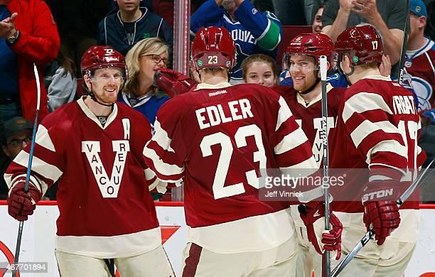 Daniel Sedin Alexander Edler and Radim Vrbata congratulate Yannick Weber of the Vancouver Canucks who scored against the Colorado Avalanche during...