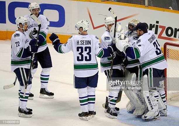 Daniel Sedin Alexander Edler Henrik Sedin Sami Salo and goaltender Roberto Luongo and backup goaltender Cory Schneider of the Vancouver Canucks...