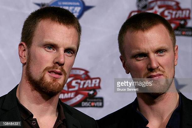 Daniel Sedin and Henrik Sedin of the Vancouver Canucks answer questions during NHL All Star Player Media Availability apart of the 2011 NHL AllStar...