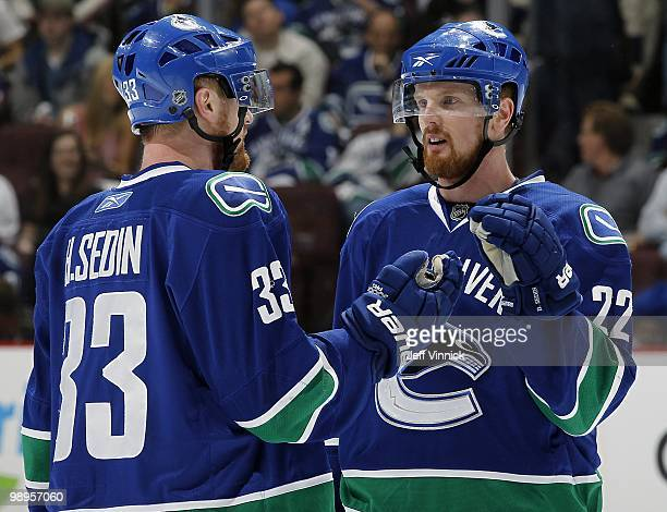 Daniel Sedin and Henrik Sedin of the Vancouver Canucks discuss strategy in Game Four of the Western Conference Semifinals against the Chicago...