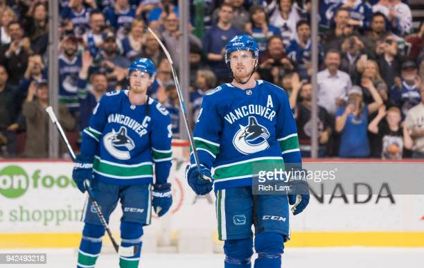 Daniel Sedin and Henrik Sedin of the Vancouver Canucks salute the fans after playing in their final home game of their career against the Arizona...