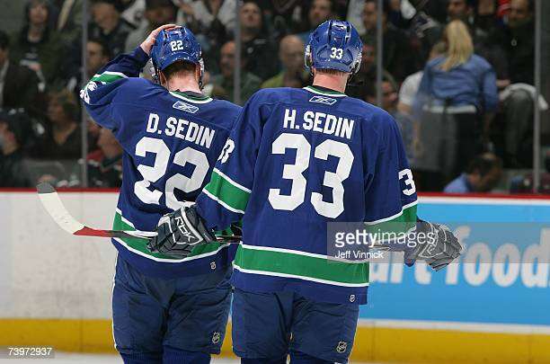 Daniel Sedin and Henrik Sedin of the Vancouver Canucks skate on the ice against the Dallas Stars during Game 7 of the 2007 Western Conference...