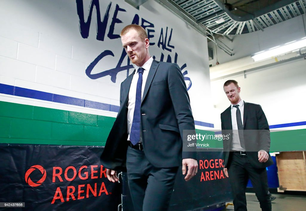 Daniel Sedin #22 (L) and Henrik Sedin #33 of the Vancouver Canucks walk to their locker room as they arrive at Rogers Arena before their NHL game against the Arizona Coyotes at Rogers Arena April 5, 2018 in Vancouver, British Columbia, Canada.