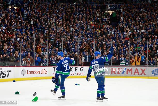Daniel Sedin and Henrik Sedin of the Vancouver Canucks wave to fans after their NHL game against the Arizona Coyotes at Rogers Arena April 5 2018 in...