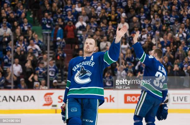 Daniel Sedin and Henrik Sedin of the Vancouver Canucks waves to the fans after playing in their final home game of their career against the Arizona...