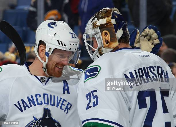 Daniel Sedin and Jacob Markstrom of the Vancouver Canucks celebrate their 42 victory against the Buffalo Sabres in an NHL game at the KeyBank Center...