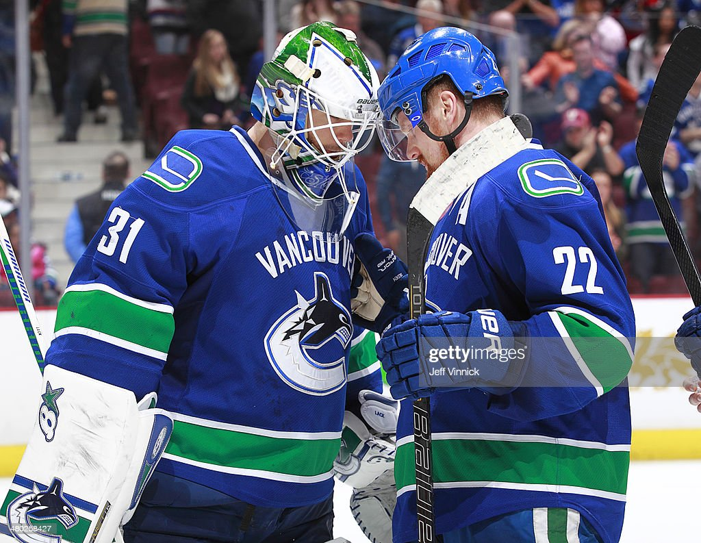 Daniel Sedin #22 congratulates Eddie Lack #31 of the Vancouver Canucks after defeating the Buffalo Sabres in their NHL game at Rogers Arena March 23, 2014 in Vancouver, British Columbia, Canada. Vancouver won 4-2.