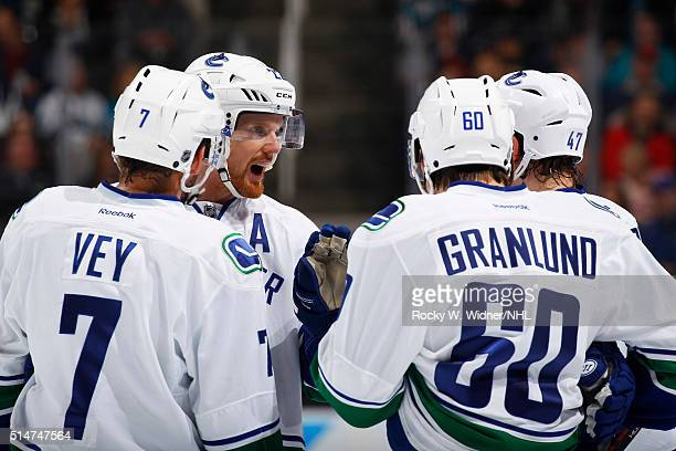 Daniel Sedin Linden Vey Markus Granlund and Sven Baertschi of the Vancouver Canucks huddle up during the game against the San Jose Sharks at SAP...