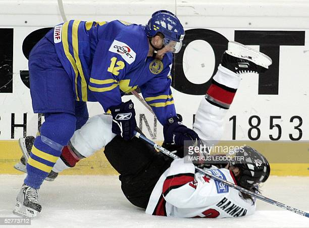Daniel Sedin of Sweden and Scott Hannan of Canada vie in the Group F Qualifiying match between Canada and Sweden at the IIHF Mens World Championship...