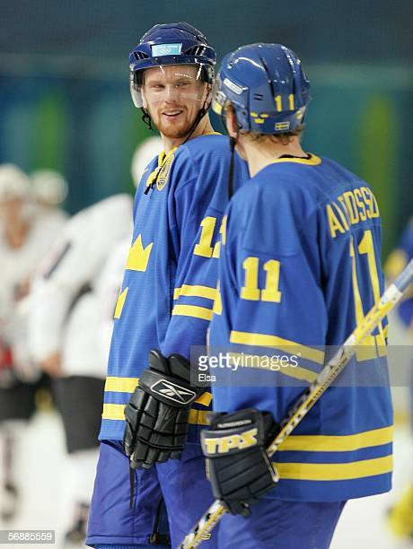 Daniel Sedin of Sweden talks to Daniel Alfredsson of Sweden during the men's ice hockey Preliminary Round Group B match between USA and Sweden during...