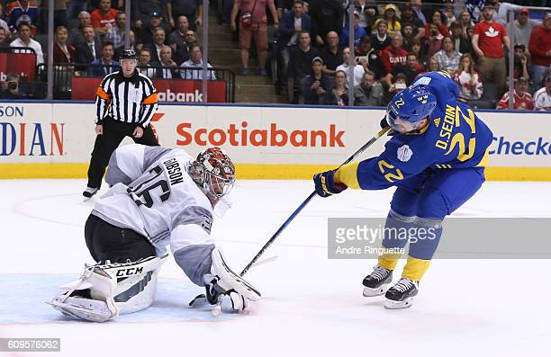 Daniel Sedin of Team Sweden tries to get the puck past Matt Murray of Team North America during the World Cup of Hockey 2016 at Air Canada Centre on...