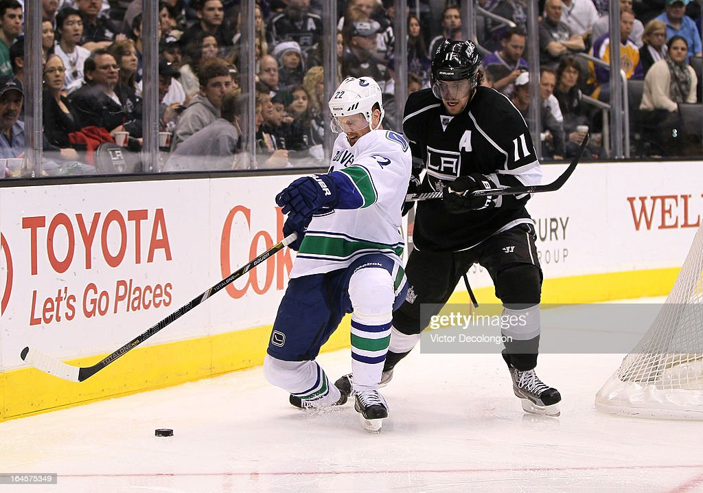 Daniel Sedin #22 of the Vancouver Canucks and Anze Kopitar #11 of the Los Angeles Kings vie for the puck during the NHL game at Staples Center on March 23, 2013 in Los Angeles, California. The Canucks defeated the Kings 1-0.