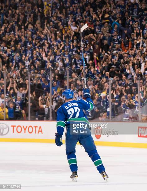 Daniel Sedin of the Vancouver Canucks celebrates after scoring the game winning goal in overtime against the Arizona Coyotes in NHL action on April...