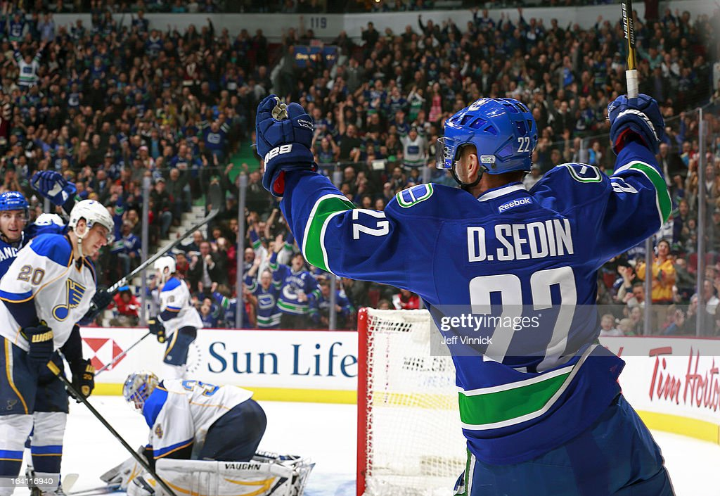 Daniel Sedin #22 of the Vancouver Canucks celebrates his goal on Jake Allen #34 of the St. Louis Blues during their NHL game at Rogers Arena March 19, 2013 in Vancouver, British Columbia, Canada. Vancouver won 3-2.
