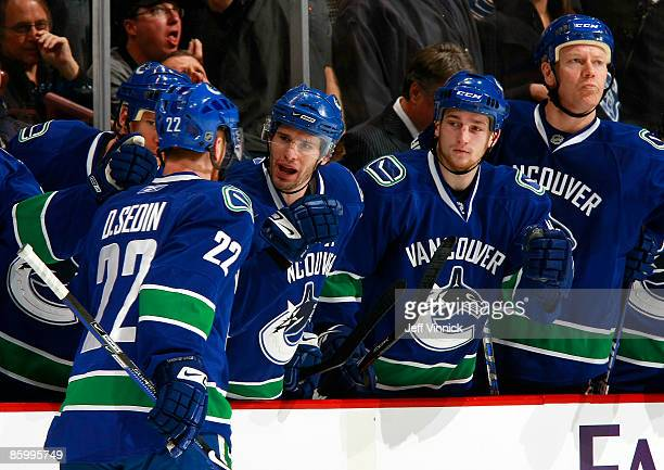 Daniel Sedin of the Vancouver Canucks celebrates his goal with teammates Ryan Johnson Ryan Kesler Rick Rypien and Mats Sundin during Game One of the...