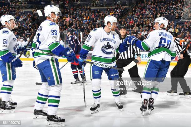 Daniel Sedin of the Vancouver Canucks celebrates his second period goal with teammates Troy Stecher Henrik Sedin and Markus Granlund of the Vancouver...