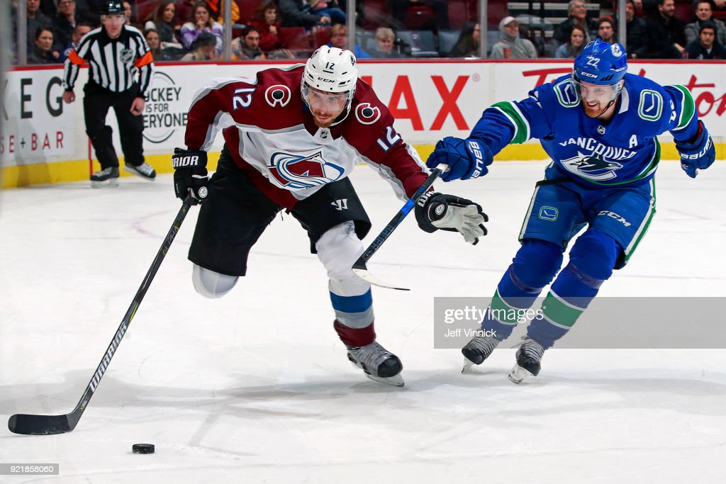 Daniel Sedin #22 of the Vancouver Canucks checks Patrik Nemeth #12 of the Colorado Avalanche during their NHL game at Rogers Arena February 20, 2018 in Vancouver, British Columbia, Canada. Colorado won 5-4.
