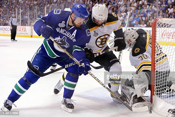 Daniel Sedin of the Vancouver Canucks collides with Johnny Boychuk of the Boston Bruins during Game Seven of the 2011 NHL Stanley Cup Final at Rogers...