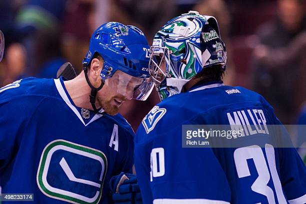 Daniel Sedin of the Vancouver Canucks congratulates goalie Ryan Miller after defeating the Chicago Blackhawks 63 in NHL action on November 2015 at...