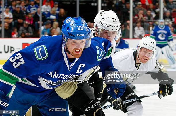 Daniel Sedin of the Vancouver Canucks Evgeni Malkin and Patric Hornqvist of the Pittsburgh Penguins follow the play during their NHL game at Rogers...