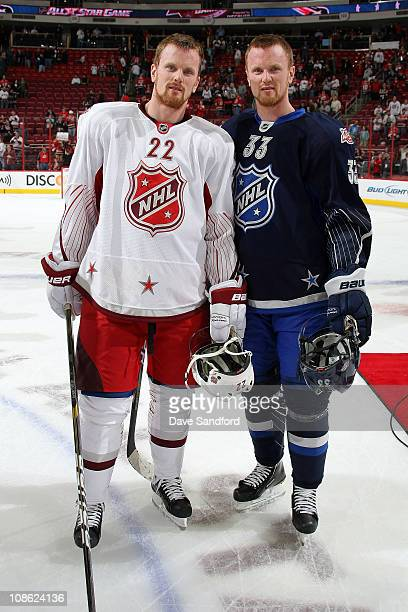 Daniel Sedin of the Vancouver Canucks for team Staal and Henrik Sedin of the Vancouver Canucks for team Lidstrom smile for a photo after the 58th NHL...