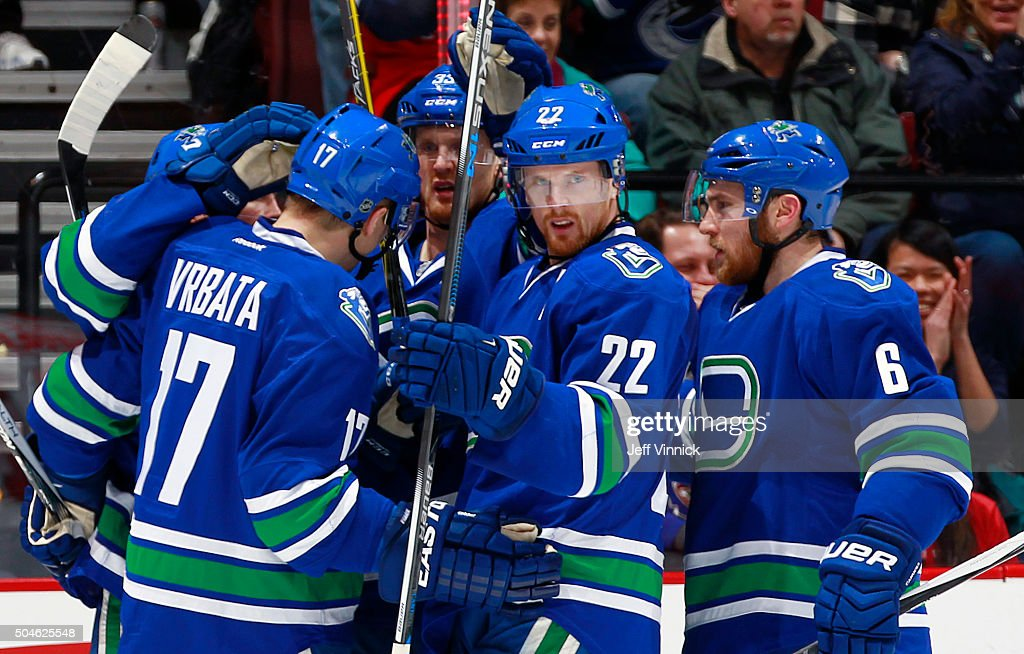Daniel Sedin #22 of the Vancouver Canucks is congratulated after scoring against the Florida Panthers during their NHL game at Rogers Arena January 11, 2016 in Vancouver, British Columbia, Canada.