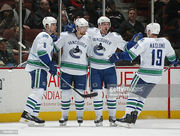 Daniel Sedin of the Vancouver Canucks is congratulated after scoring in the first period against the Anaheim Ducks on December 12 2007 at the Honda...