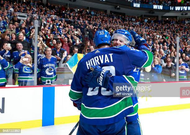 Daniel Sedin of the Vancouver Canucks is congratulated by teammate Bo Horvat after scoring the overtime winning goal during their NHL game against...