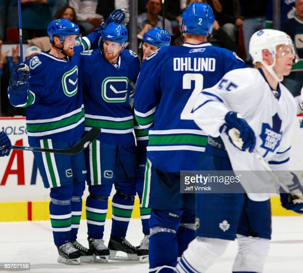 Daniel Sedin of the Vancouver Canucks is congratulated by teammates after scoring a goal during their game against the Toronto Maple leafs at General...
