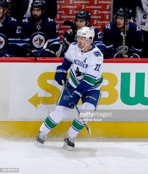 Daniel Sedin of the Vancouver Canucks keeps an eye on the play during third period action against the Winnipeg Jets at the Bell MTS Place on December...