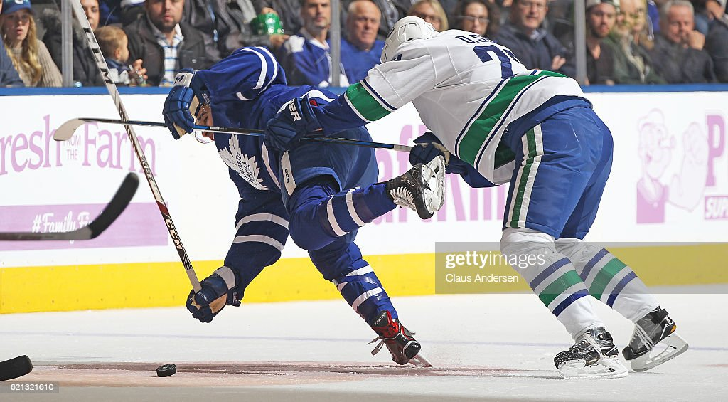 Daniel Sedin #22 of the Vancouver Canucks knocks down Nazem Kadri #43 of the Toronto Maple Leafs during an NHL game at the Air Canada Centre on November 5, 2016 in Toronto, Ontario, Canada. The Leafs defeated the Canucks 6-3.
