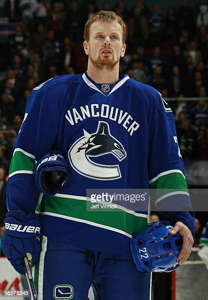 Daniel Sedin of the Vancouver Canucks listens to the National Anthems before their game against the Los Angeles Kings at General Motors Place on...