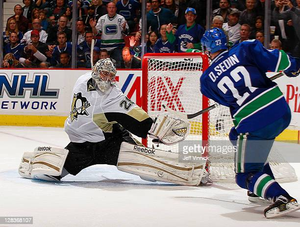 Daniel Sedin of the Vancouver Canucks misses the net against MarcAndre Fleury of the Pittsburgh Penguins late in the third period of the NHL game...