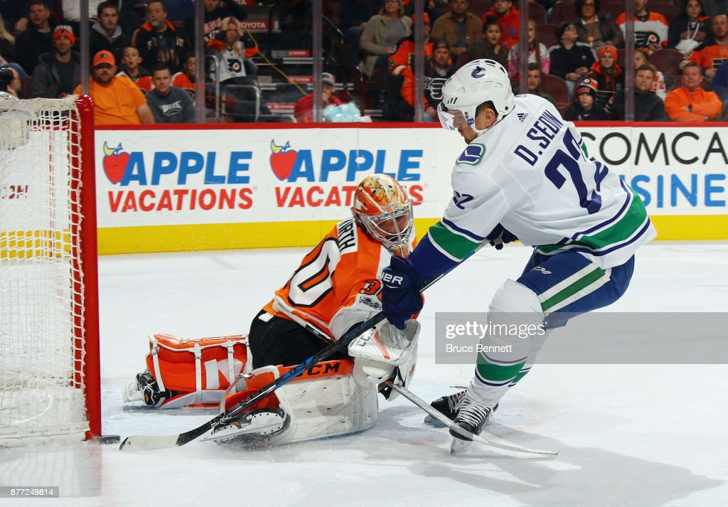 Daniel Sedin #22 of the Vancouver Canucks scores at 9:42 of the first period against Michal Neuvirth #30 of the Philadelphia Flyers at the Wells Fargo Center on November 21, 2017 in Philadelphia, Pennsylvania.
