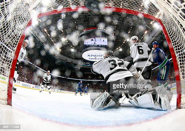 Daniel Sedin of the Vancouver Canucks scores on Jonathan Quick of the Los Angeles Kings on the 700th career assist by Henrik Sedin of the Canucks...