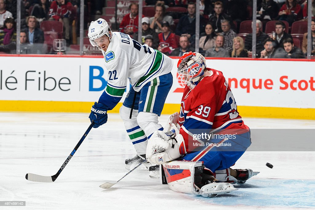 Daniel Sedin #22 of the Vancouver Canucks screens goaltender Mike Condon #39 of the Montreal Canadiens during the NHL game at the Bell Centre on November 16, 2015 in Montreal, Quebec, Canada. The Montreal Canadiens defeated the Vancouver Canucks 4-3 in overtime.