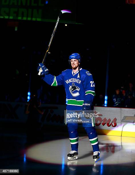 Daniel Sedin of the Vancouver Canucks steps onto the ice during their NHL game against the Edmonton Oilers at Rogers Arena October 11 2014 in...