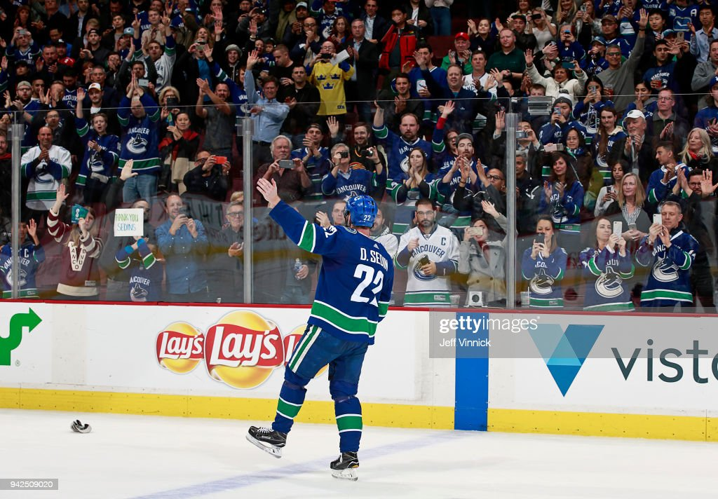 Daniel Sedin #22 of the Vancouver Canucks waves to fans after their NHL game against the Arizona Coyotes at Rogers Arena April 5, 2018 in Vancouver, British Columbia, Canada.