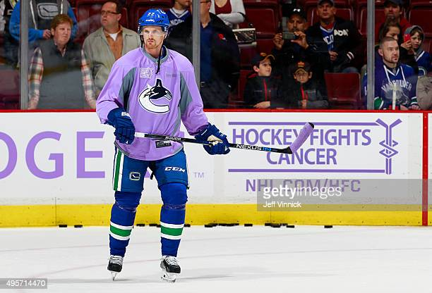 Daniel Sedin of the Vancouver Canucks wears a lavender Hockey Fights Cancer jersey for warmup before their NHL game against the Pittsburgh Penguins...
