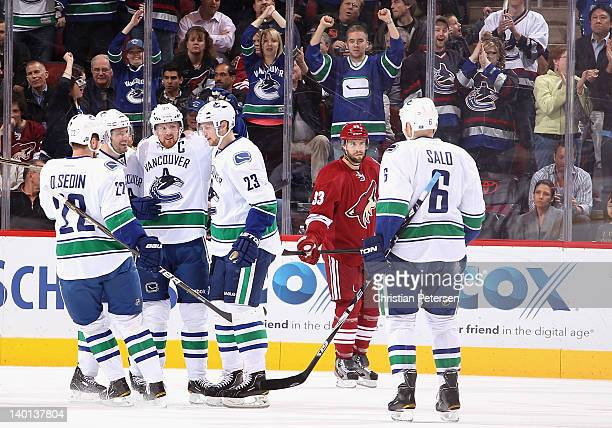 Daniel Sedin, Ryan Kesler, Henrik Sedin, Alexander Edler and Sami Salo of the Vancouver Canucks celebrate after Edler scored a first-period...