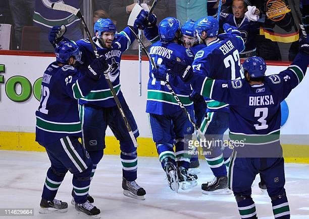 Daniel Sedin Ryan KeslerAlex Burrows Henrik Sedin Alexander Edler and Kevin Bieksa of the Vancouver Canucks celebrate Kesler's goal to tie the game...