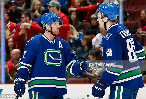 Daniel Sedin talks strategy with Nikita Tryamkin of the Vancouver Canucks during their NHL game against the Chicago Blackhawks at Rogers Arena March...