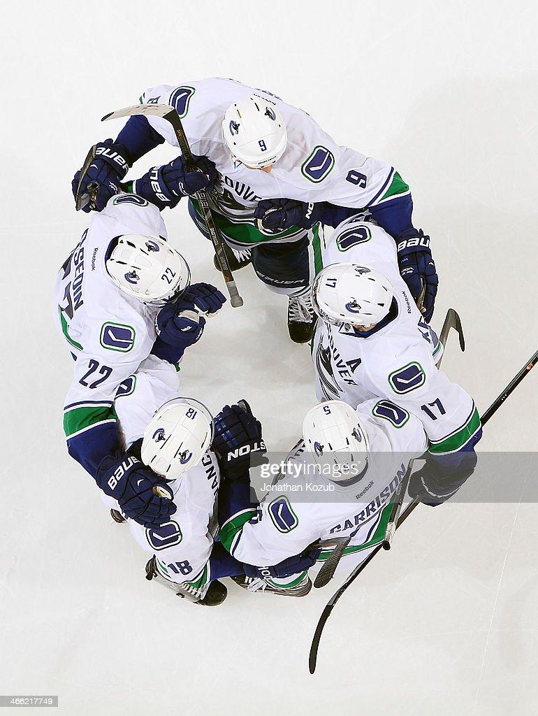 Daniel Sedin #22, Zack Kassian #9, Ryan Kesler #17, Jason Garrison #5 and Ryan Stanton #18 of the Vancouver Canucks celebrate a third period goal against the Winnipeg Jets at the MTS Centre on January 31, 2014 in Winnipeg, Manitoba, Canada.