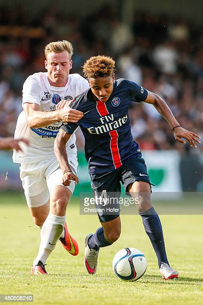 Daniel Seper of Wiener Sportklub competes for the ball with Christopher Nkunku of Paris Saint-Germain during the Friendly Match between Wiener...